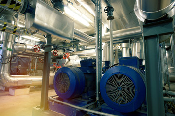different size and shaped pipes, valves and pumps  at a power plant