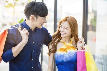 happy couple shopping in urban street.