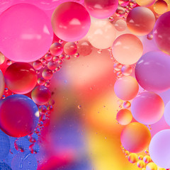 Abstract colorful Background Oil in Water surface Foam of Soap with Bubbles macro shot close-up