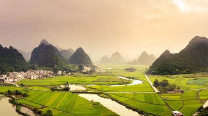 Stunning rice fields and karst formations scenery in Guangxi pro