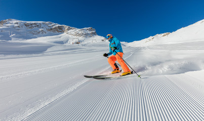 Wall Mural - Young man skiing downhill in Alps