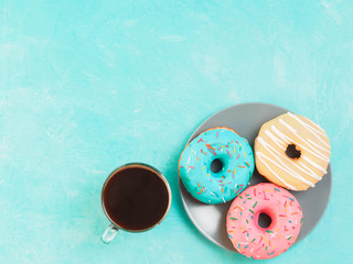 donuts on blue background , copy space, top view