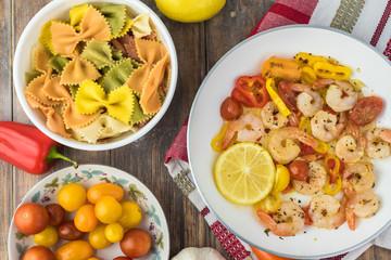 Shrimp veggie colorful bowtie pasta.