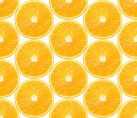 Seamless background with slices of orange fruits on white