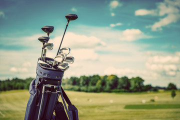 Fotobehang Golf Golf equipment bag standing on a course.