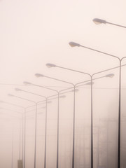 Light Poles in a Row in The Fog Held