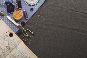 Workspace of fashion designer, top view