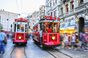Old red tram goes on Istiklal street