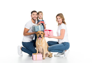 happy family and dog with presents, isolated on white