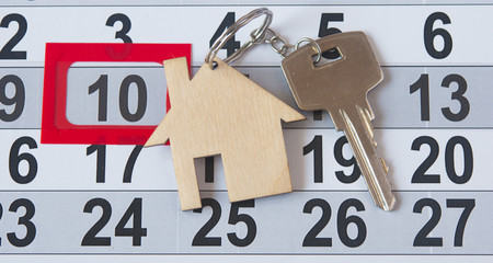 A house key on a calendar background