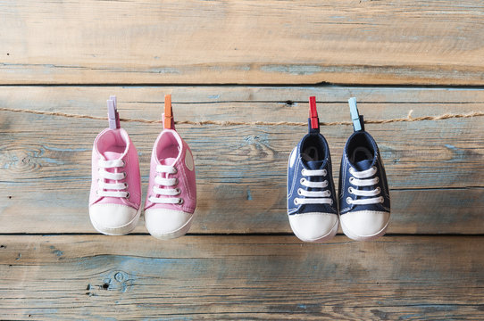 Baby shoes hanging on the clothesline.