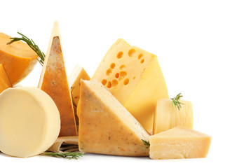Different types of delicious cheese on white background