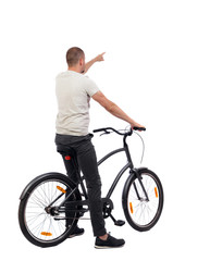 back view of pointing man with a bicycle.