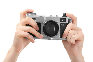 Photographer holding retro camera on white background