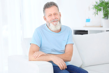 Portrait of mature man in casual clothes indoors