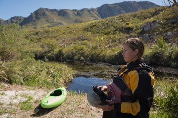 Woman standing with kayak boat