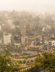 Kathmandu city view and prayer flags after sunrise