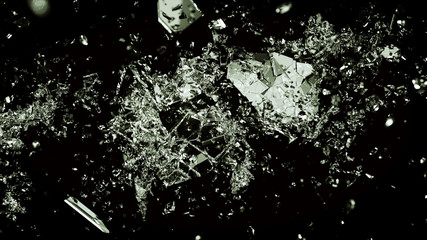 Pieces of splitted or broken glass on black