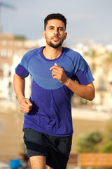 healthy young man running outdoors