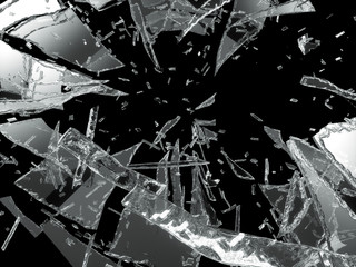 Damaged or broken glass over black