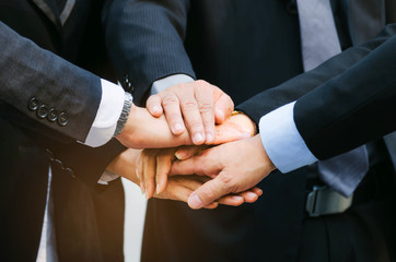 close up group of big business people team joining hands together in the modern city, team leader, successful, support, meeting, partner, teamwork, community and connection concept, selective focus