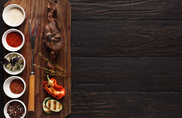Grilled meat and vegetables on rustic wooden board