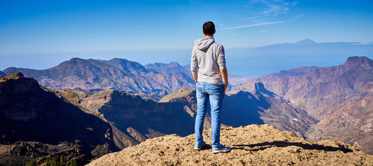 Looking at view of Canary Island Gran Canaria / Man standing on top of a mountain