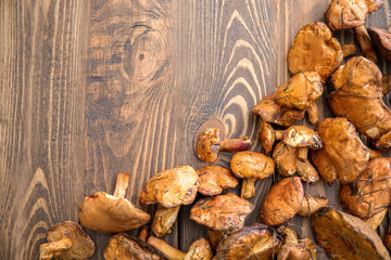 Raw forest mushrooms on wooden table