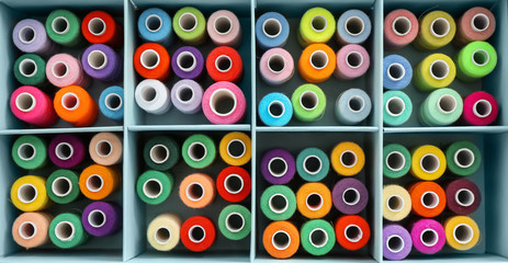 Set of color sewing threads in compartment box, top view