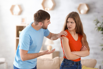 Couple arguing at home. Problems in relationship