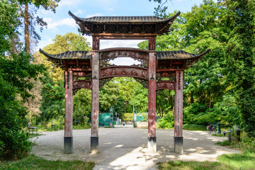 Rear view of the old wooden chinese gateway standing at the main entrance of the garden of tropical agronomy in Paris.