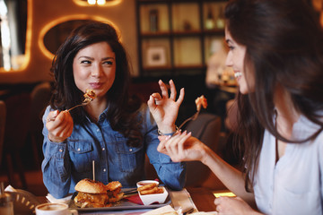 Two young women at lunch in a restaurant