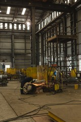 Welder repairing vessel part