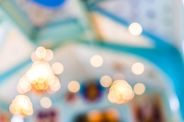 Bokeh abstract background of bright lights inside blue orthodox church