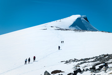 Hikers ascending Glittertind, Jotunheimen, Norway