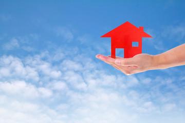 Man Holding House  on sky
