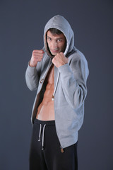 Profile view of young man practicing boxing .Personal instructor. Personal training.
