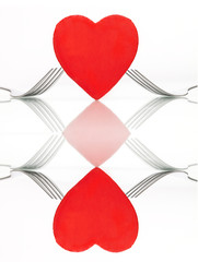 Wall Mural - Collage of two images: heart with forks on table