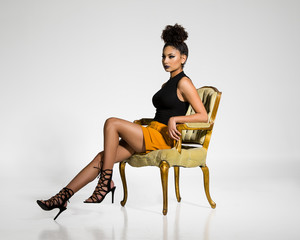 Fashion Model Posing in a Chair