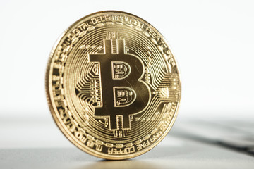 New virtual money Golden bitcoin coin on a white. Cryptocurrency. Business and Trading concept.