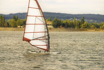 windsurfing at the surface of the reservoir
