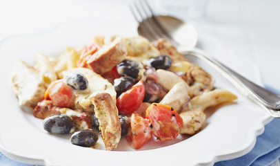 Chicken baked with penne pasta and cheese. Italian cuisine.