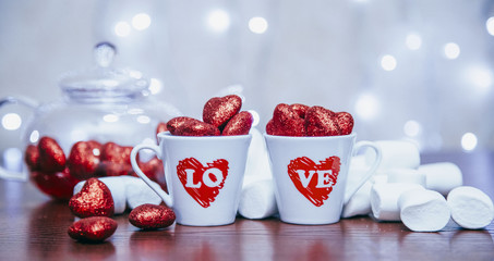 two cups with decorate red heart of valentine style