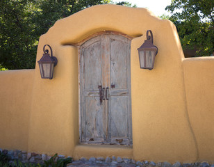 Southwest Style Adobe Carved Wood Door with Lanterns