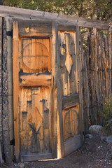 Old Rustic Wooden Carved Doors with Coyote Fence