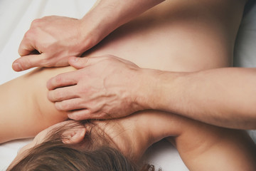 Massage procedures on shoulders, back and cervical department