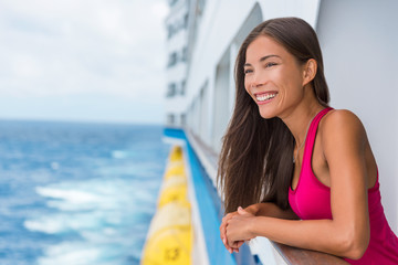 Wall Mural - Happy Asian travel tourist woman relaxing on cruise ship deck enjoying summer Europe destination vacation cruising on sea.