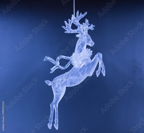 Glass deer Christmas decorations close-up, crystal deer Christmas tree