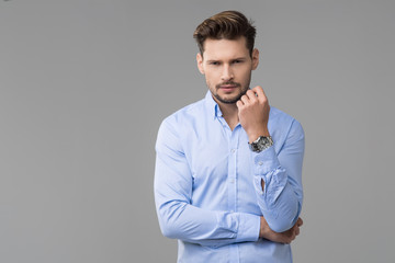 Happy handsome man with watch