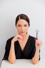 portrait of woman in lagom style with metal key